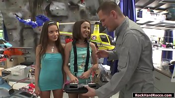 Two slutty teens fool around in the toy workshop to borrow some remote control.The guy gives them and after that,they broke the remote control.They let the guy lick their asses so that he will be mad.They suck his cock and lets him fuck their asses.